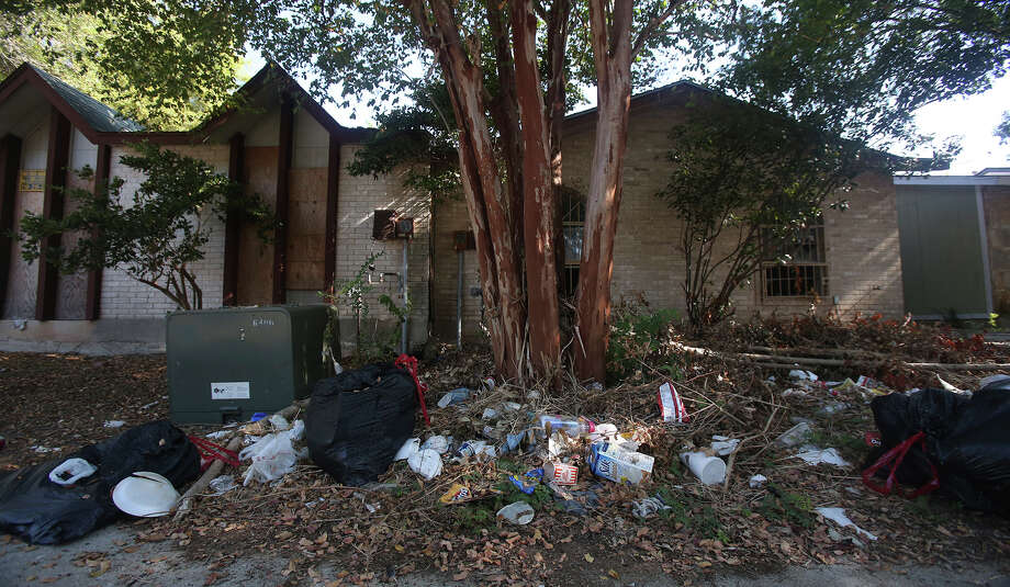 These two properties, at 6803 and 6805 Oldham Drive in Camelot II, have been allowed to fall into serious disrepair. Photo: John Davenport /San Antonio Express-News / ©San Antonio Express-News/John Davenport