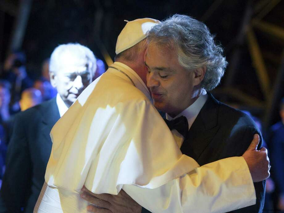 Pope Francis embraces Italian tenor Andrea Bocelli during a mass he celebrated in Philadelphia. Readers commend the pope for his grace and humanity. Photo: /Associated Press / L'Osservatore Romano