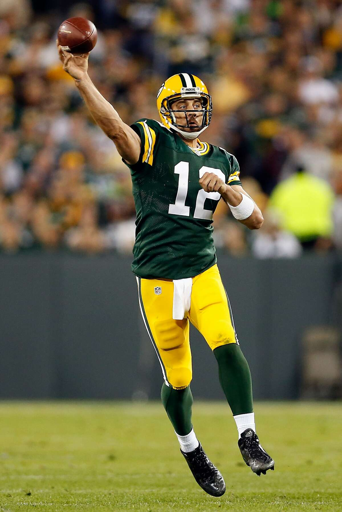 GREEN BAY, WI - SEPTEMBER 20: Aaron Rodgers #12 of the Green Bay Packers throws the ball in the second quarter against the Seattle Seahawks during their game at Lambeau Field on September 20, 2015 in Green Bay, Wisconsin. (Photo by Christian Petersen/Getty Images)