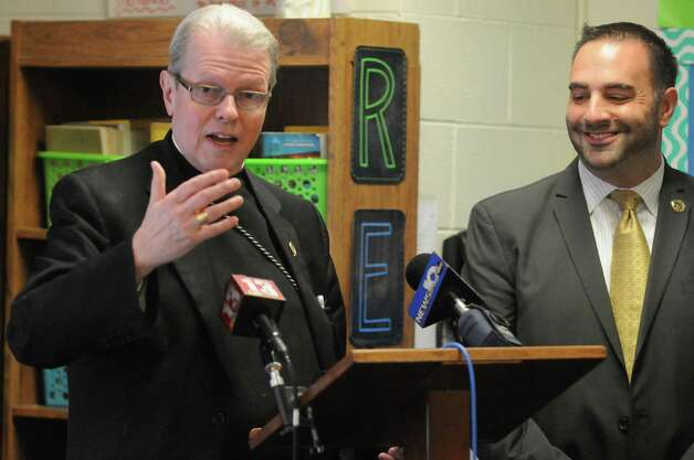 Bishop Edward B. Scharfenberger and Michael Pizzingrillo, Superintendent of Schools for the Roman Catholic Diocese of Albany, announce a major shift in the way Common Core-New York State Assessments are implemented at Catholic elementary and middle schools at St. Madeleine Sophie School on Friday Oct. 2, 2015 in Schenectady , N.Y.  (Michael P. Farrell/Times Union) Photo: Michael P. Farrell / 10033609A
