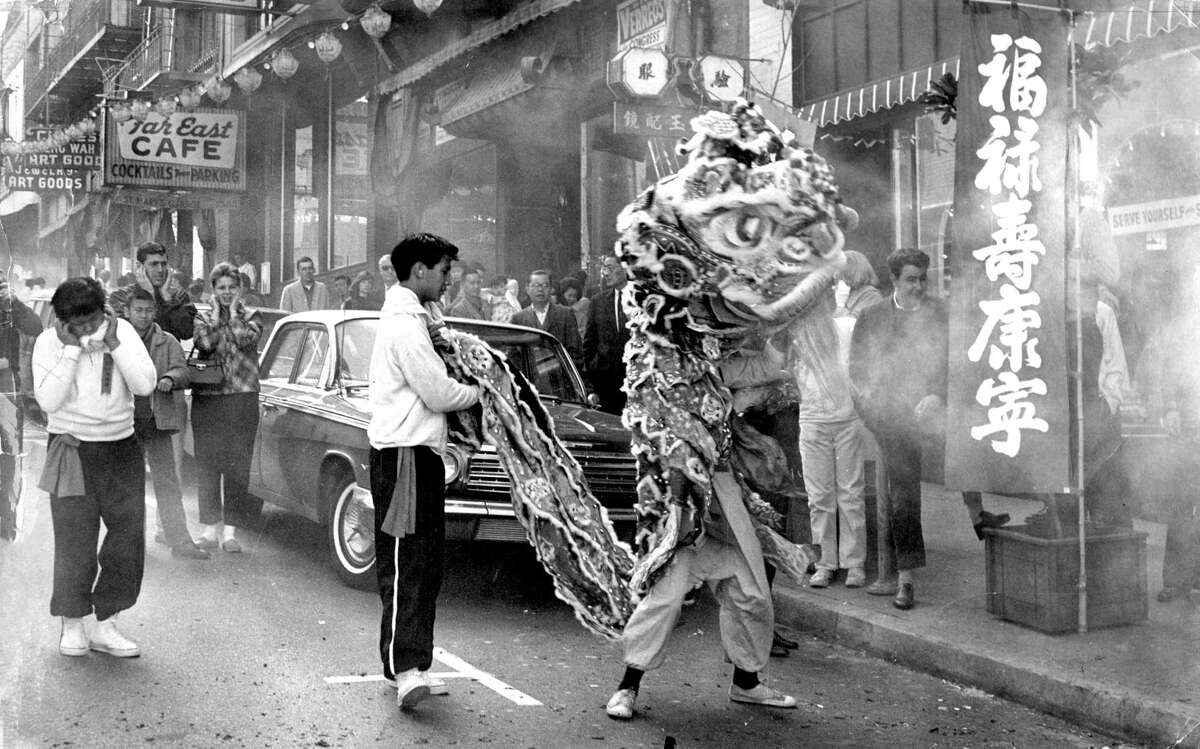 A lion dancer moves through the fireworks' haze in San Francisco's Chinatown on Feb. 16, 1964.