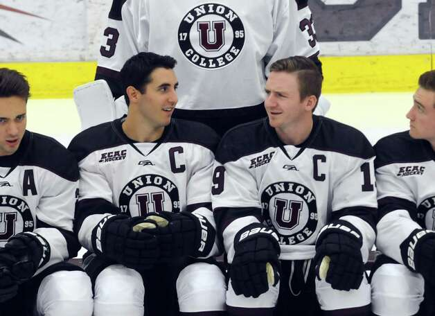 Union College men's hockey co-captains Mike Vecchione, center left, and Matt Wikins, center, right, talk as the team photo is set up during media day at the Union College Messa Rink on Friday Oct. 2, 2015 in Schenectady , N.Y.  (Michael P. Farrell/Times Union) Photo: Michael P. Farrell / 10033575A