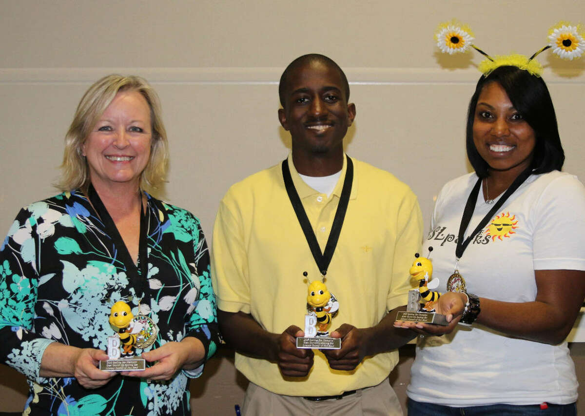 The second team of perfect spellers was the B-Team of Sugar Land, from left, Carla Latham, Austin Pennington, and Sandy Fontenot, sponsored by Linbeck Engineering.