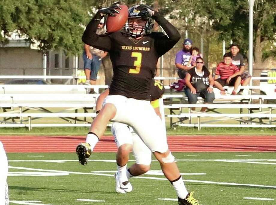 Texas Lutheran linebacker Jake Bahr intercepts a pass that he returned 3 yards for a touchdown during a 56-28 victory over Southwestern Assemblies of God on Sept 26, 2015, at Bulldog Stadium in Seguin. Photo: Courtesy Photo / Texas Lutheran Athletics