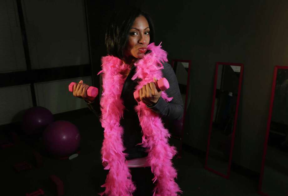 Crystal Hadnott, founder of the Naked Fine Piletto, says doing Pilates moves in stilettos results in a tougher workout. Photo: Jon Shapley, Staff / © 2015 Houston Chronicle