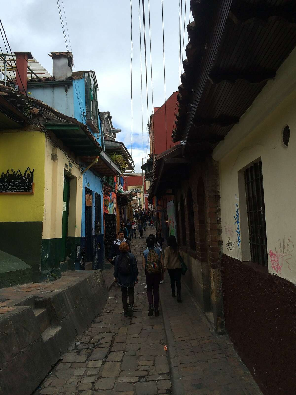 A small alley in Bogota, Colombia, near the old plaza upon which Bogot was founded by the Chorro de Quevedo fountain. Several chicher as serve the drink chicha there.