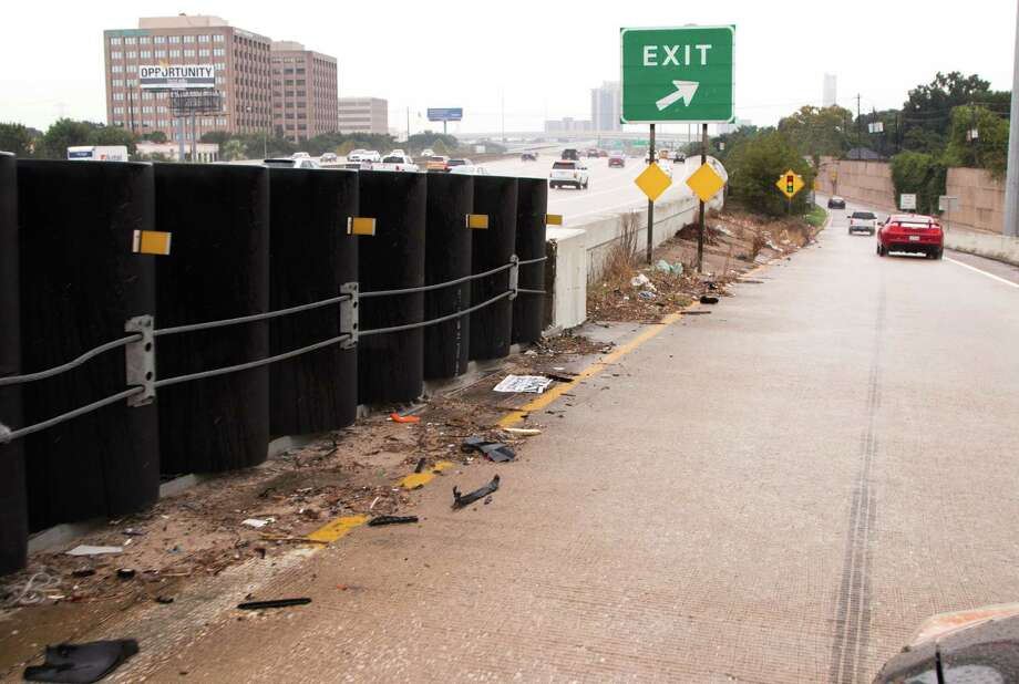 Litter along the Newcastle Drive exit off the Southwest Freeway in Houston.