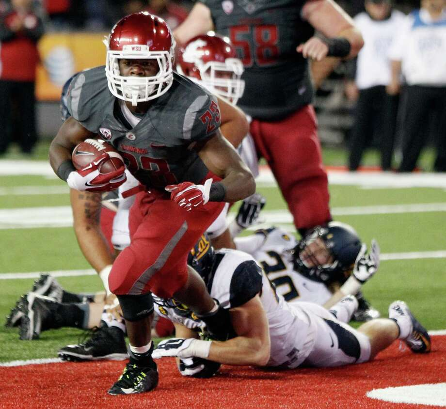 PULLMAN, WA - OCTOBER 04:  Gerard Wicks #23 of the Washington State Cougars scores a touchdown against the California Golden Bears in the second half at Martin Stadium on October 4, 2014 in Pullman, Washington.  California defeated Washington State 60-59.  (Photo by William Mancebo/Getty Images) Photo: William Mancebo / Getty Images / 2014 Getty Images