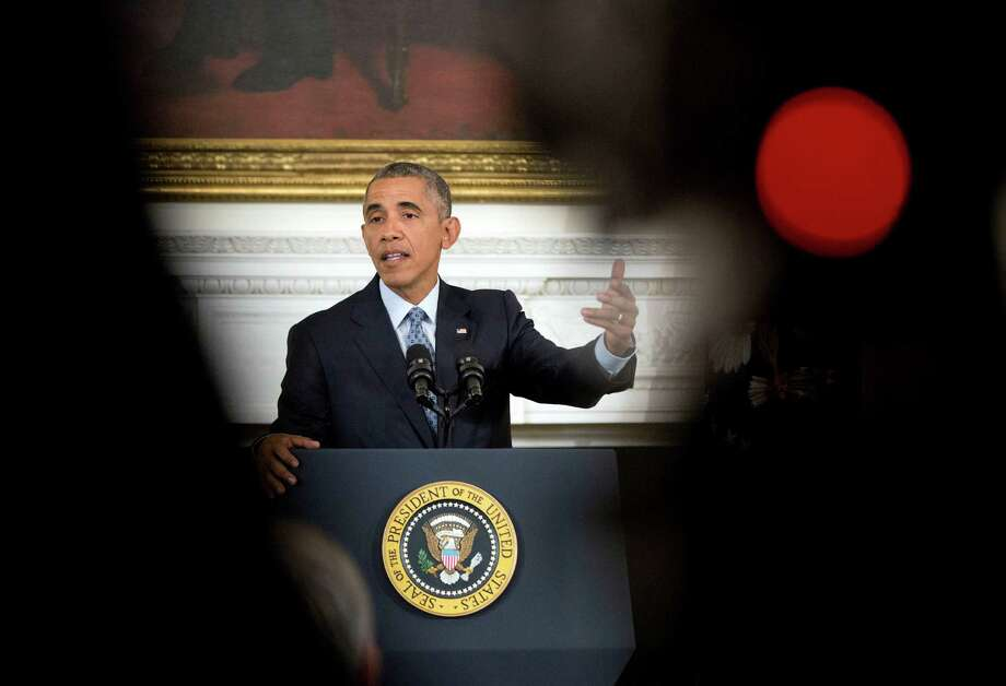 President Barack Obama gestures as he answers question during a news conference in the State Dining Room of the White House in Washington, Friday, Oct. 2, 2015. (AP Photo/Pablo Martinez Monsivais) Photo: Pablo Martinez Monsivais, STF / AP