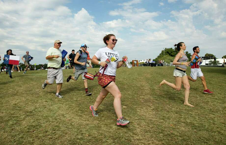 People sprint to try to get a a good spot at the front of the Samsung Galaxy Stage for the Foo Fighters show at the Austin City Limits Music Festival in Zilker Park on Friday, Oct. 2, 2015, in Austin, Texas.  (Jay Janner/Austin American-Statesman via AP) Photo: Jay Janner, MBO / Associated Press / Austin American-Statesman