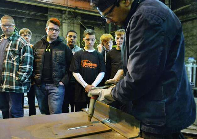 Mohonasen students watch as Richie Rampersaub, right, demonstrates submerged arc welding during their tour of STS Steel Friday Oct. 2, 2015 in Schenectady, NY.  (John Carl D'Annibale / Times Union) Photo: John Carl D'Annibale / 10033592A