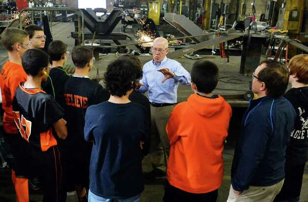 STS Steel president Glenn Tabolt, center, leads a tour of Mohonasen High students through his shop Friday Oct. 2, 2015 in Schenectady, NY.  (John Carl D'Annibale / Times Union) Photo: John Carl D'Annibale / 10033592A