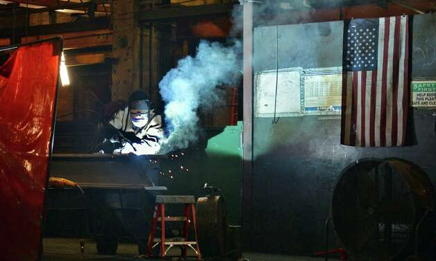 Welder Kwesi Ware at STS Steel Friday Oct. 2, 2015 in Schenectady, NY.  (John Carl D'Annibale / Times Union) Photo: John Carl D'Annibale / 10033592A