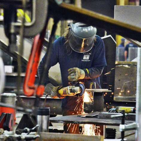 Fabricator John Schoebel works on a bridge column at STS Steel Friday Oct. 2, 2015 in Schenectady, NY.  (John Carl D'Annibale / Times Union) Photo: John Carl D'Annibale / 10033592A