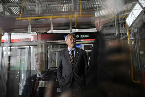 Mayor Ed Lee gets a look at the interior of a new MUNI bus during a press conference announcing MUNI service improvements, in San Francisco, CA Monday, September 28, 2015.