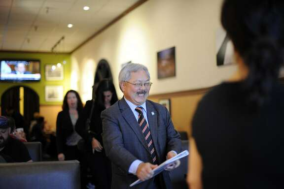 Mayor Ed Lee laughs as he leaves an affordable housing development meeting with colleagues at Sam's Diner in San Francisco, CA Monday, September 28, 2015.