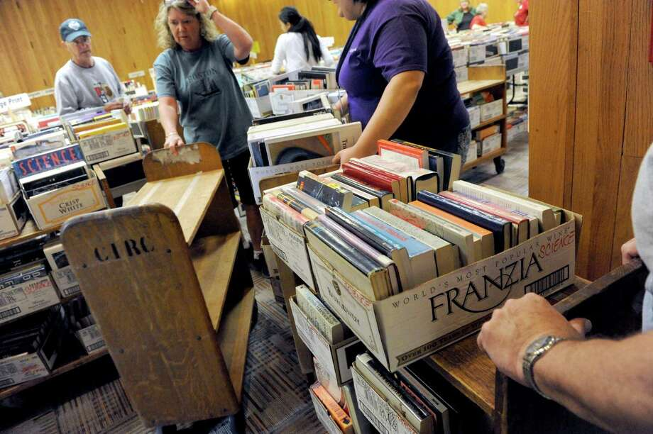 Volunteers set up 40,000 books for sale during the Friends of the Schenectady County Public Library's annual fall used book sale at Schenectady Public Library on Friday Oct. 2, 2015, in Schenectady , N.Y. The sale takes place at  9 a.m. to 4 p.m. Saturday in and outside the library at 99 Clinton Street.   (Michael P. Farrell/Times Union) Photo: Michael P. Farrell / 00033510A