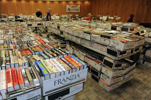 Volunteers set up 40,000 books for sale during the Friends of the Schenectady County Public Library?s annual fall used book sale at Schenectady Public Library on Friday Oct. 2, 2015 in Schenectady , N.Y. The sale takes place at  9 a.m. to 4 p.m. Saturday in and outside the library at 99 Clinton Street.   (Michael P. Farrell/Times Union) Photo: Michael P. Farrell / 00033510A
