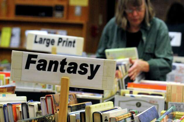 Volunteers set up 40,000 books for sale during the Friends of the Schenectady County Public Library's annual fall used book sale at Schenectady Public Library on Friday Oct. 2, 2015 in Schenectady , N.Y. The sale takes place at  9 a.m. to 4 p.m. Saturday Oct. 3, 2015 in and outside the library at 99 Clinton Street.   (Michael P. Farrell/Times Union) Photo: Michael P. Farrell / 00033510A
