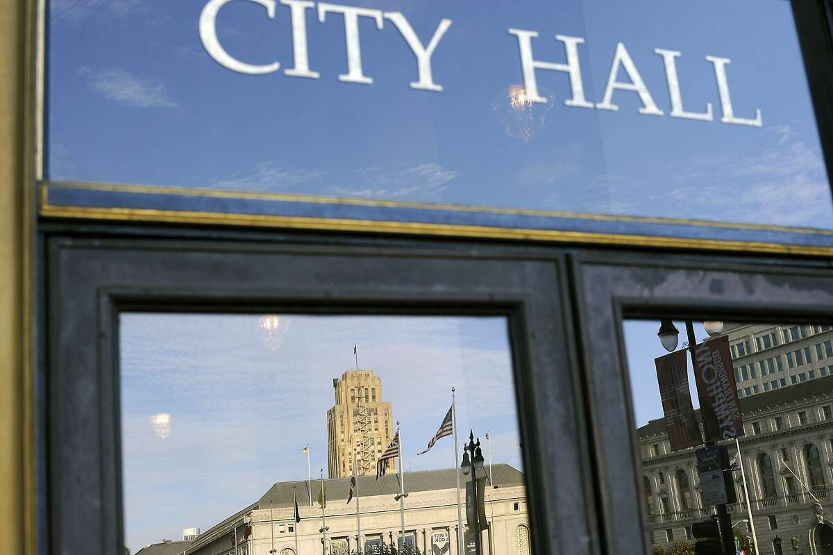 Reflections in the door at City Hall in San Francisco, CA Monday, September 28, 2015.