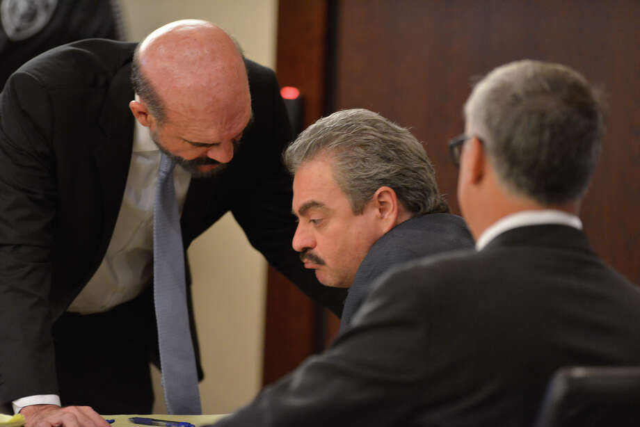 Mark Anthony Gonzales (center), who is accused of capital murder in the shooting death of Bexar County Sheriff Sgt. Kenneth Vann, consults with attorney's Paul Goeke (left) and Kurt Gransee (right) at the beginning of his trial Tuesday. Photo: Robin Jerstad, Freelancer / For The Express-News / San Antonio Express-News