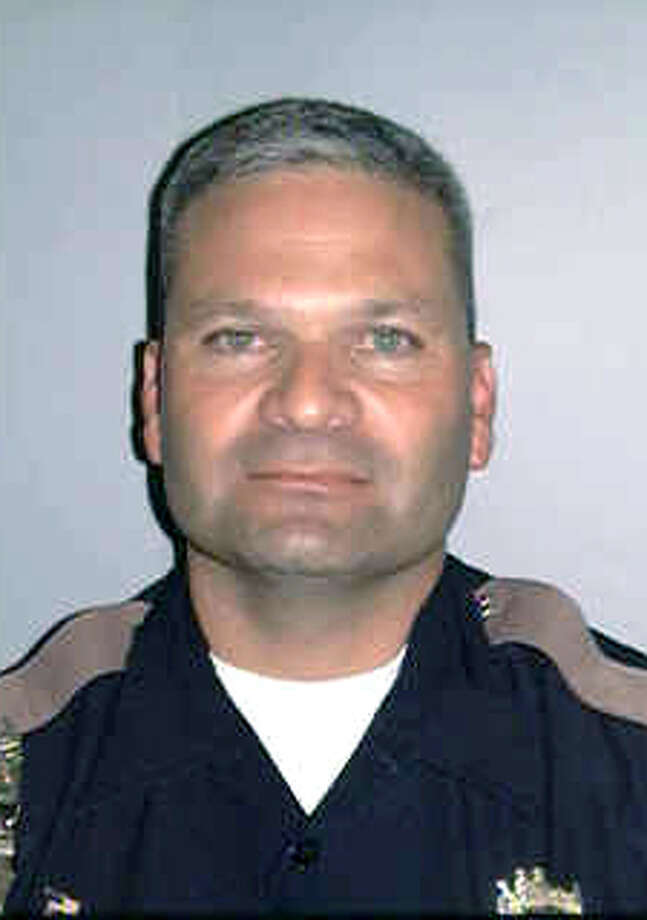 This undated picture provided by the Bexar County Sheriff's Office shows Bexar County Sgt. Kenneth Vann. The sherrif's deputy was shot and killed early May 28, 2011 at the intersection of Loop 410 and Rigsby Avenue in San Antonio, Texas when a car pulled up alongside his marked patrol car and ambushed him, opening fire with what officials believe was a semi automatic weapon. Vann, 48, was a 24 year veteran of the department. He is the first deputy killed in the line of duty in the department since 2003. (AP Photo/Bexar County Sheriff's Office via The San Antonio Express-News) Photo: AP / BEXAR COUNTY SHERIFF'S OFFICE