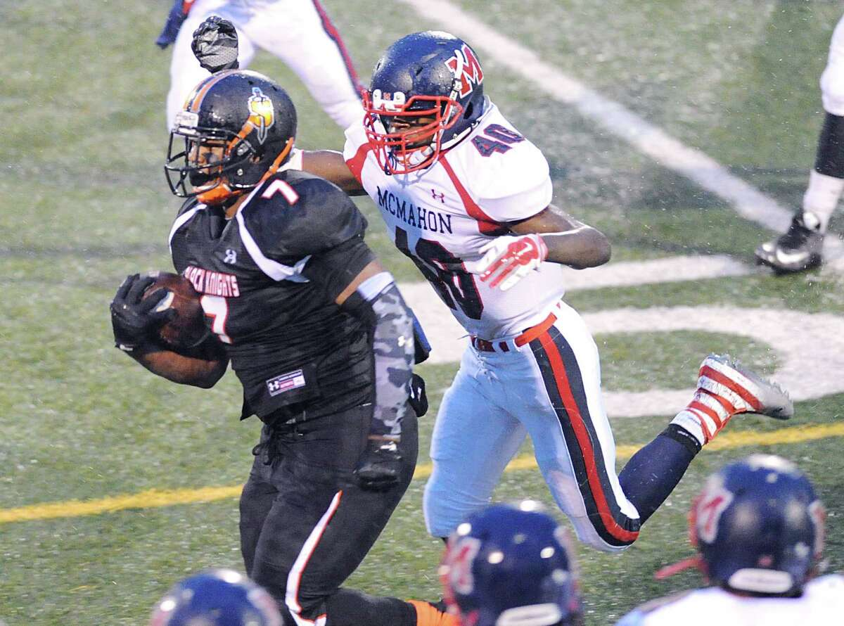 Stamford's Tyrell Diaz leaves Brien McMahon's Jared Fields (40) behind on his way to a 75-yard touchdown Friday night at Boyle Stadium.
