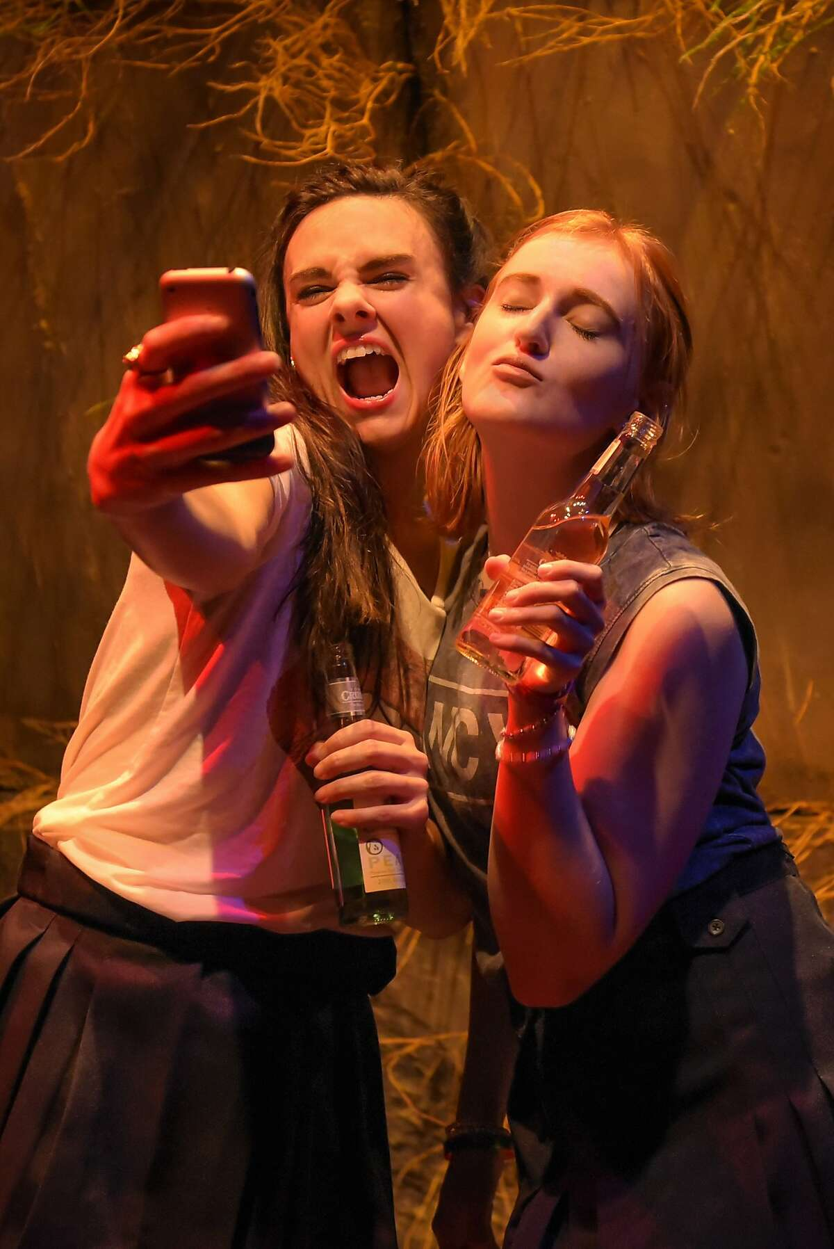 Childhood best friends Kelly (Chelsea Looy, right) and Sam (Jessica Lynn Carroll) navigate adolescence in the digital age in Crowded Fire Theater's American premiere of