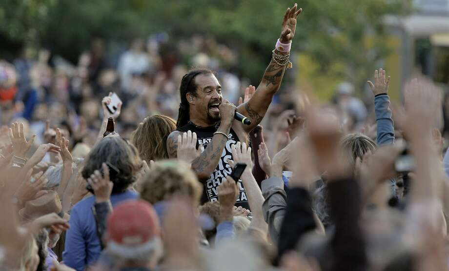 Michael Franti goes out into the crowd filled meadow for a few songs, play the Banjo Stage, during the first day of Hardly Strictly Bluegrass in Golden Gate Park on Fri. October 2, 2015,  in San Francisco, Calif., Photo: Michael Macor, The Chronicle