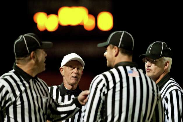 Officials share some camaraderie during halftime of the Green Tech vs. Burnt Hills football game on Friday, Oct. 2, 2015, at Burnt Hill High in Burnt Hills, N.Y. From left are line judge John Weismann, head referee Andy Yager, back judge Mike Dunn and head lineman Carl Miller. Not shown is umpire Joe Curro. (Cindy Schultz / Times Union) Photo: Cindy Schultz / 10033586A