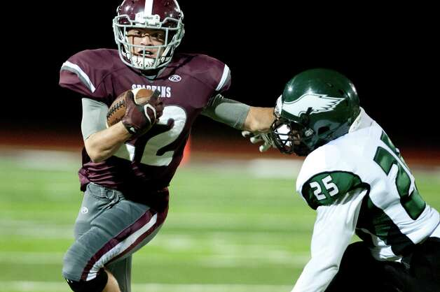 Burnt Hills' Michael Leveroni, left, stiff arms Green Tech's Damair Skervin during their football game on Friday, Oct. 2, 2015, at Burnt Hill High in Burnt Hills, N.Y. (Cindy Schultz / Times Union) Photo: Cindy Schultz / 10033586A