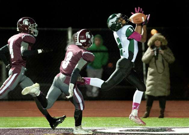 Green Tech's Raki Johnson, right, catches a touchdown pass as Burnt Hills' Matthew DeLano, left, and Jacob Shippey defend during their football game against Burnt Hills on Friday, Oct. 2, 2015, at Burnt Hill High in Burnt Hills, N.Y. (Cindy Schultz / Times Union) Photo: Cindy Schultz / 10033586A