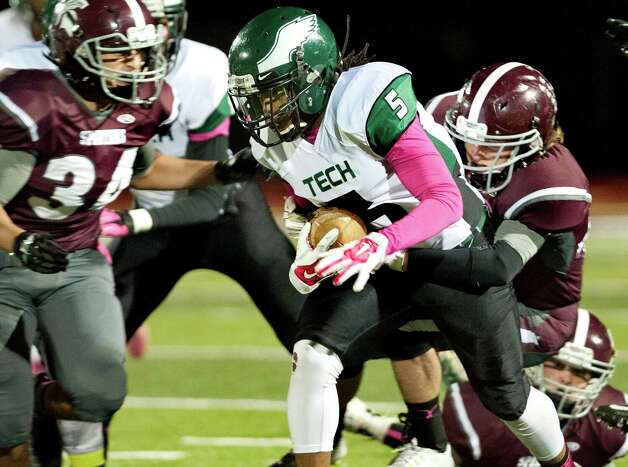 Green Tech's Tyler Dobbs, center, runs into heavy traffic during their football game against Burnt Hills on Friday, Oct. 2, 2015, at Burnt Hill High in Burnt Hills, N.Y. (Cindy Schultz / Times Union) Photo: Cindy Schultz / 10033586A
