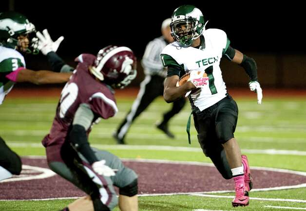 Green Tech's Ahzir Turner, right, carries the ball during their football game against Burnt Hills on Friday, Oct. 2, 2015, at Burnt Hill High in Burnt Hills, N.Y. (Cindy Schultz / Times Union) Photo: Cindy Schultz / 10033586A