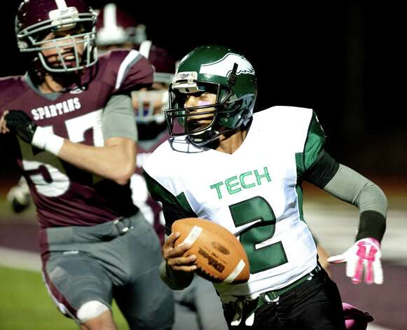Green Tech's quarterback James Holmes, right, carries the ball as Burnt Hills' Adam Hansen defends during their football game on Friday, Oct. 2, 2015, at Burnt Hill High in Burnt Hills, N.Y. (Cindy Schultz / Times Union) Photo: Cindy Schultz / 10033586A