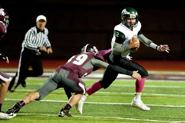 Green Tech's quarterback James Holmes, right, scrambles with the ball as Burnt Hills' Ricky Rodriguez defends during their football game on Friday, Oct. 2, 2015, at Burnt Hill High in Burnt Hills, N.Y. (Cindy Schultz / Times Union) Photo: Cindy Schultz / 10033586A