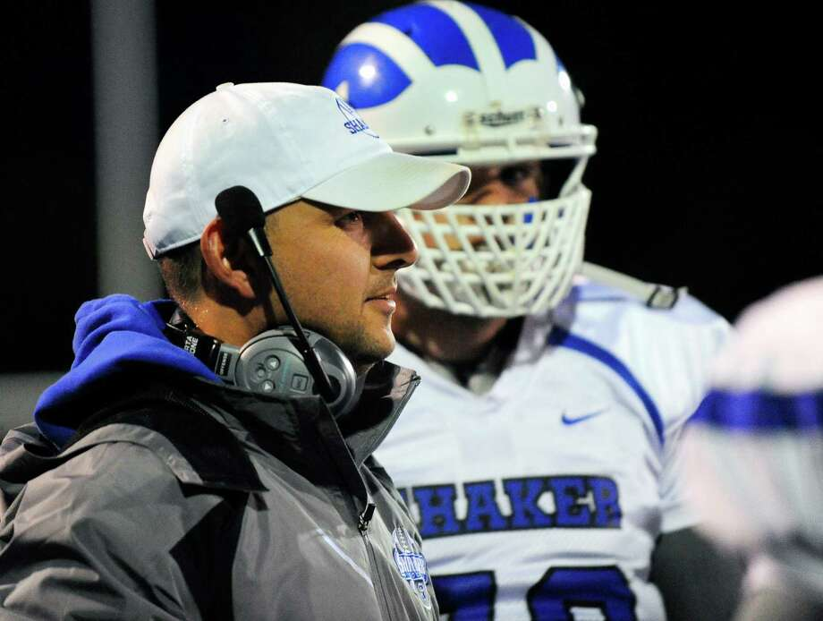 Shaker head coach Greg Sheeler instructs his players against La Salle during the first half of their high school football game in Troy, N.Y., Friday, Oct. 2, 2015. (Hans Pennink / Special to the Times Union) ORG XMIT: HP101 Photo: Hans Pennink / 10033605A