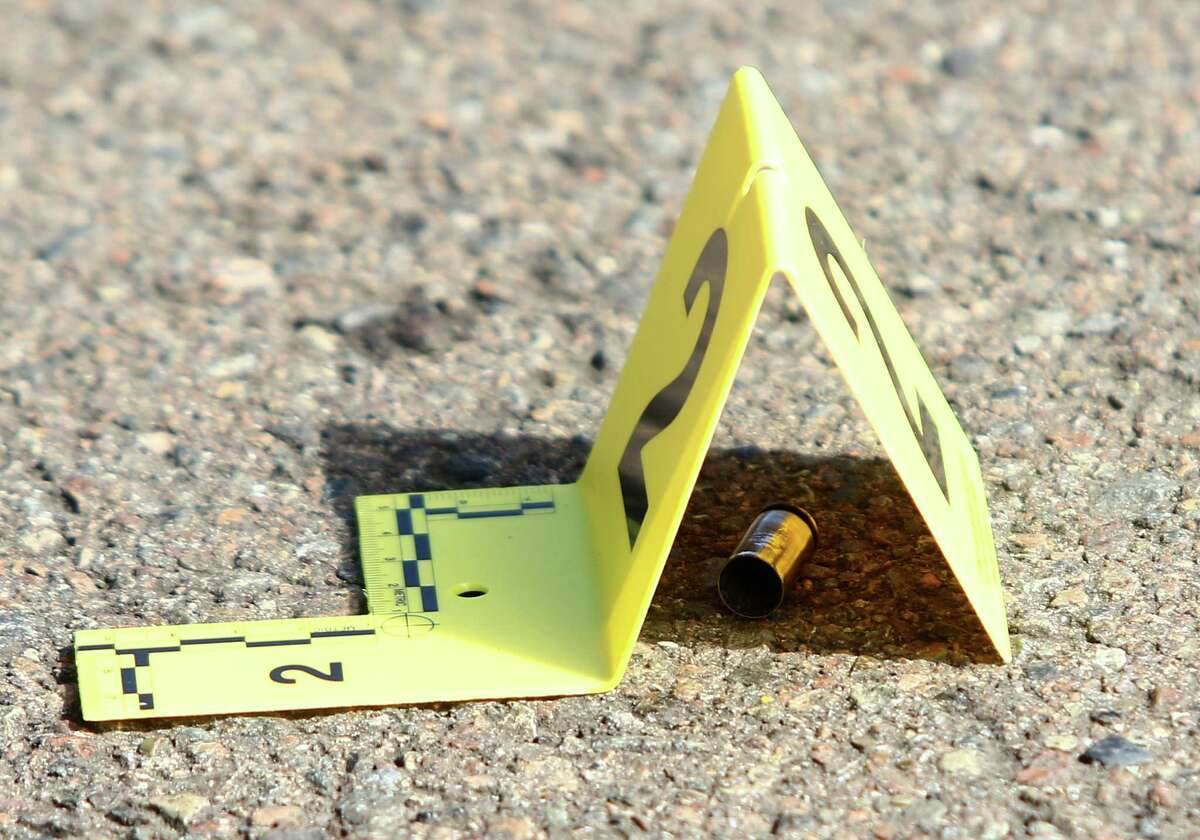 A bullet casing is marked at the scene of a deadly shooting at Umpqua Community College in Roseburg, Ore., Thursday, Oct. 1, 2015. (Michael Sullivan/The News-Review via AP) MANDATORY CREDIT