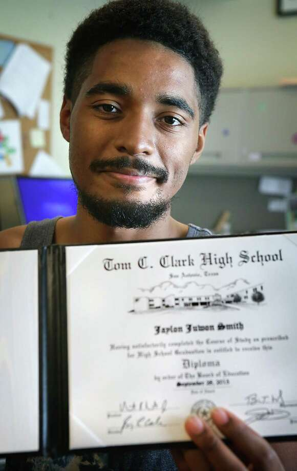 Jaylon Smith holds his diploma from Clark High School. Staff members at Haven for Hope threw him a surprise graduation party. Smith wants to become a computer engineer. Photo: Bob Owen /San Antonio Express-News / San Antonio Express-News
