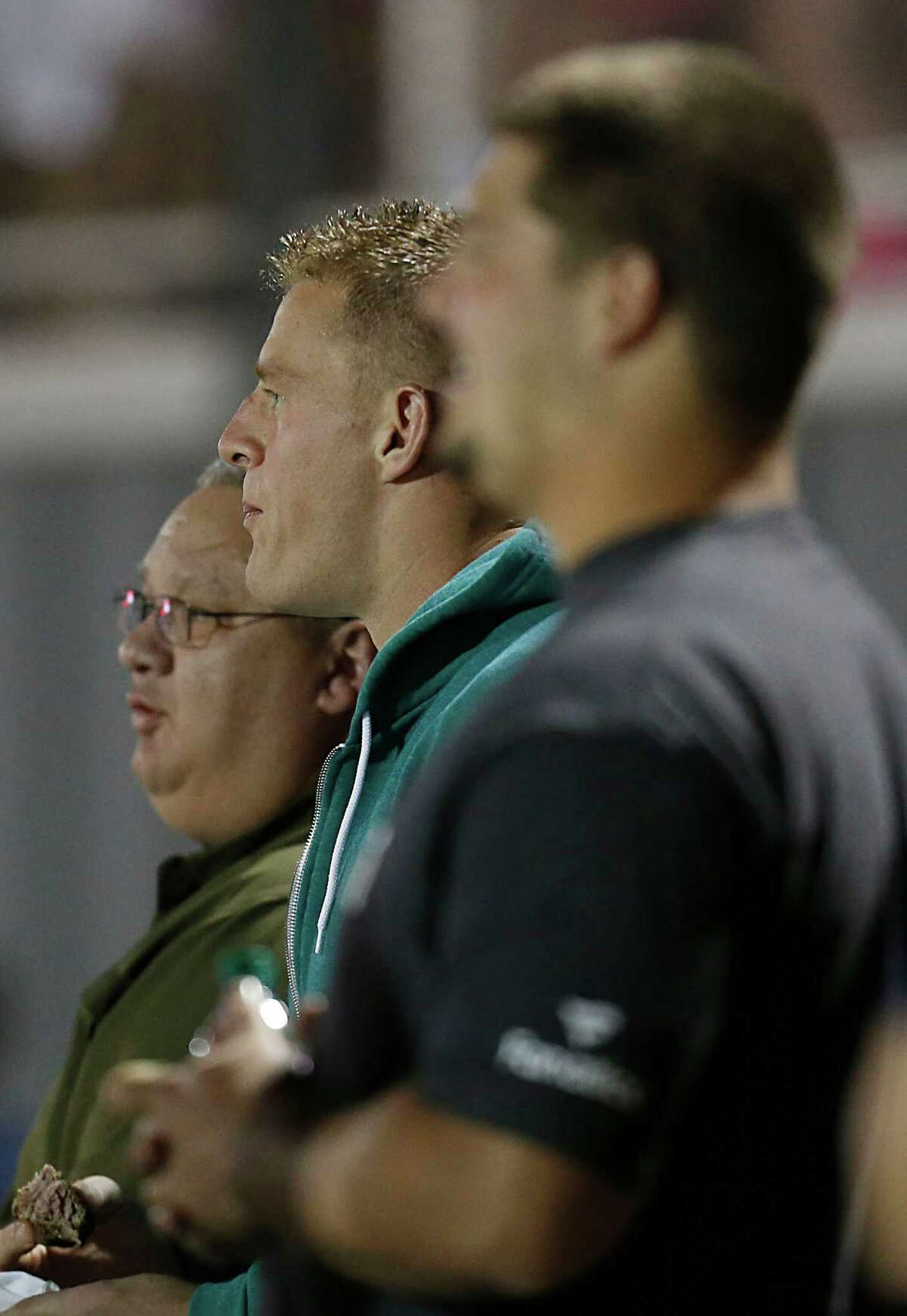 Houston Texans JJ Watt watches the game between the Pearland Oilers and Dawson Eagles at the Rig on October 2, 2015 in Pearland, Texas. Oiler won 28 to 27 .