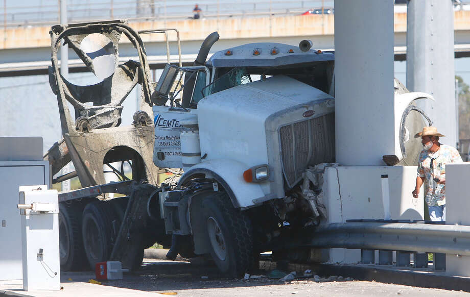 A cement truck crashed into an unmanned toll booth Friday on the inbound Hardy Toll Road near Tidwell. The driver was rushed to a hospital.  Photo: Cody Duty, Staff / © 2015 Houston Chronicle