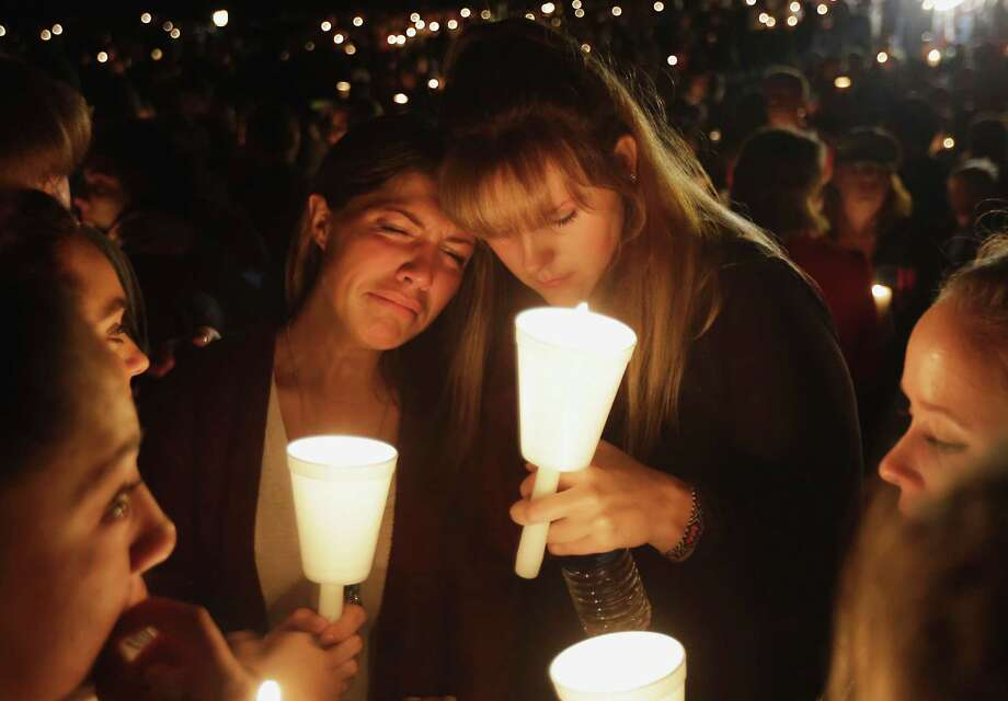 Kristen Sterner, left, and Carrissa Welding, both students of Umpqua Community College, embrace each other during a candle light vigil for those killed during a fatal shooting at the college, Thursday, Oct. 1, 2015, in Roseburg, Ore. (AP Photo/Rich Pedroncelli) ORG XMIT: ORRP101 Photo: Rich Pedroncelli / AP