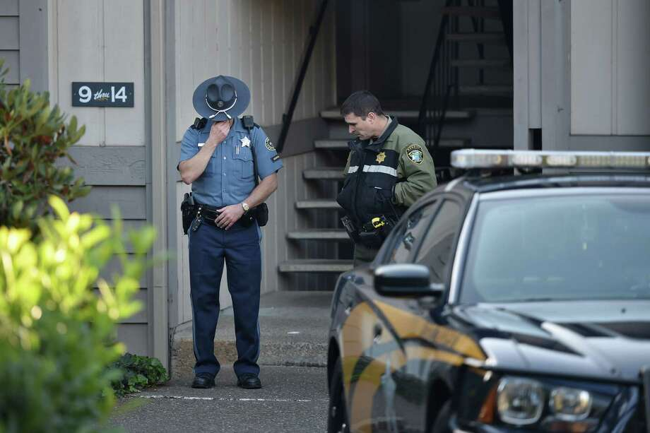 Police officers stand guard outside the apartment building where the alleged gunman, Chris Harper Mercer, lived in Roseburg, Oregon, on October 2, 2015. The rampage on October 1 at Umpqua Community College left 10 dead and shattered a close-knit rural community in the south of the state. AFP PHOTO/JOSH EDELSONJosh Edelson/AFP/Getty Images ORG XMIT: 582572437 Photo: JOSH EDELSON / Josh Edelson / AFP