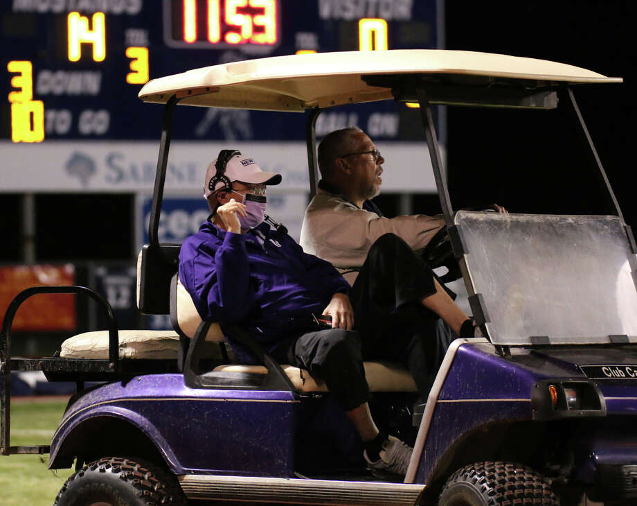 Newton coach W.T. Johnston encourages the team from his familiar golf cart on the sidelines during the game between the WO-S Mustangs and the Newton Eagles at Dan R. Hooks Stadium in Orange, Friday night October 2nd, 2015 - Photo provided by Kyle Ezell