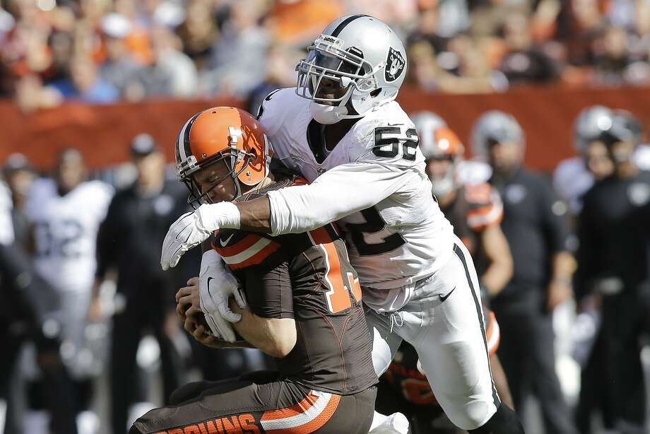 Khalil Mack sacks Cleveland QB Josh McCown, one of two sacks Mack had in the Raiders' 27-20 win over the Browns. Photo: Aaron Josefczyk, Associated Press