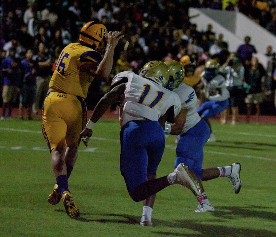 Elkins DL Kenneth Orji (11) putting pressure on Galveston Ball QB Gannon Rawlins (16) during the first half of action between Elkins vs. Galveston Ball high schools during a football game at the Courville Stadium, Friday, Oct. 2, 2015, in Galveston. (Juan DeLeon / For the Houston Chronicle) Photo: Juan DeLeon / Houston Chronicle