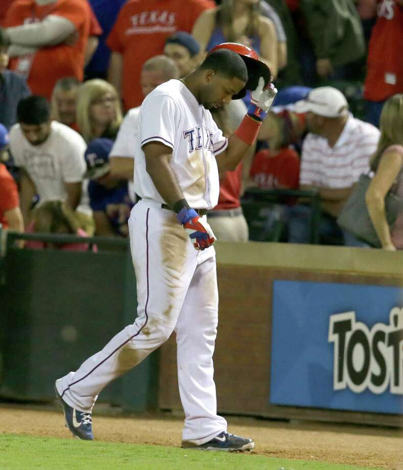 Texas Rangers Elvis Andrus walks off the field after flying out ending the ninth inning of a baseball game against the Los Angeles Angels in Arlington, Texas, Friday, Oct. 2, 2015. The Angels won 2-1. (AP Photo/LM Otero)   ORG XMIT: ARL121 Photo: LM Otero / AP
