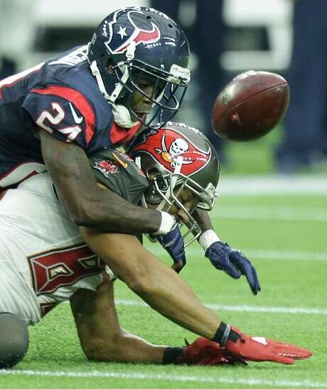 Texans cornerback Johnathan Joseph (24) breaks up a pass intended for Bucs receiver Vincent Jackson. Photo: Brett Coomer, Staff / © 2015  Houston Chronicle