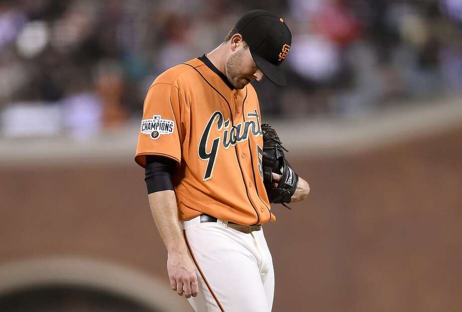 Chris Heston #53 of the San Francisco Giants reacts after giving up a two-run RBI double to Jose Reyes #7 of the Colorado Rockies in the top of the fourth inning at AT&T Park on October 2, 2015 in San Francisco, California. Photo: Thearon W. Henderson, Getty Images