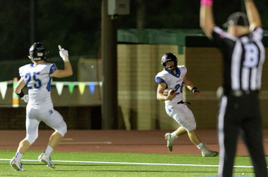 Episcopal's Jake Levrier (28) scores one of his three touchdowns Friday night in a 42-21 win over Kinkaid at Segal Field. He finished the game with 239 total yards. Photo: Wilf Thorne / © 2015 Houston Chronicle